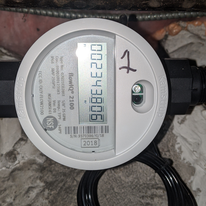 Image of a flow iq water submeter in a basement